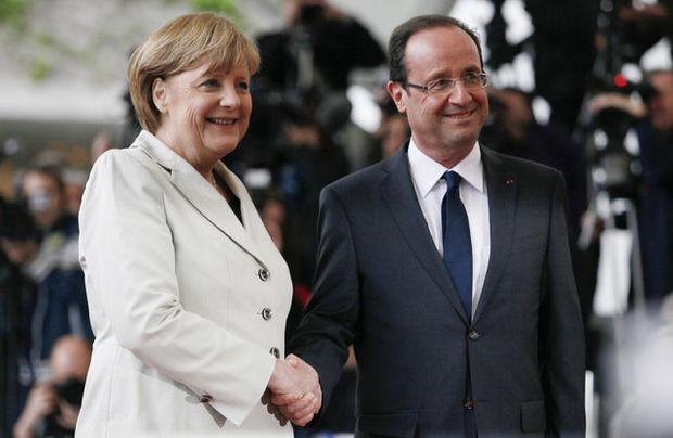 Tandemul Merkel - Hollande, relansat. Cancelarul german îl curtează pe preşedintele francez